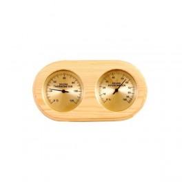 Thermometer, hygrometer, wooden sauna golden background